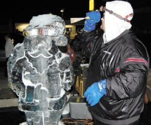 Greg Butauski of Rock On Ice forms Santa's head with a chisel at last year's Christmas Under the Clock in Plain City.