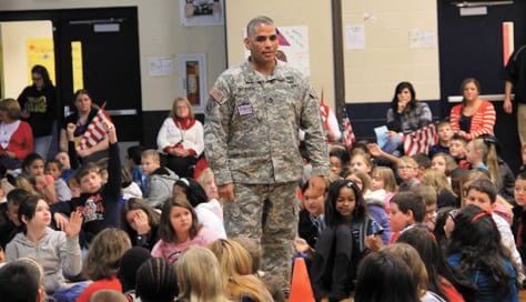 Messenger photo by Kari Donahue Master Sergeant Sepulveda speaks to students at Franklin Woods Intermediate School about why he wanted to be a soldier. He encouraged students to set goals and work hard to achieve them. More than a dozen service members visited the school for a Veterans Day assembly earlier this month.