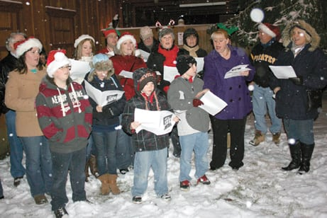The Groveport United Methodist Church choir sang carols as people awaited the arrival of Santa in Groveport on Dec. 6.