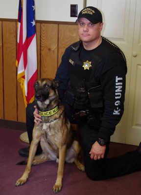 Messenger photo by Michelle Dupler Officers with the Franklin Township Police Department have to think outside the box to fund protection for Falco, the department's K9 officer. Here, Falco sits with his handler Joe Mullins.