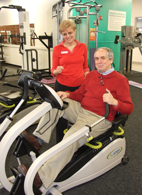 Messenger photo by Andrea Cordle Barbara Camfield assists Frank Torma as he works out on a stationary bike at the Hilltop YMCA. Torma is taking part in a diabetes prevention program at the branch.