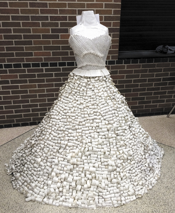 """Carlie Mentzer's """"A Dress of Many Words"""" is made up of pages torn from books. The sculpture is one of 300 art pieces from across the state selected for the annual Ohio Governor's Youth Art Exhibition."""