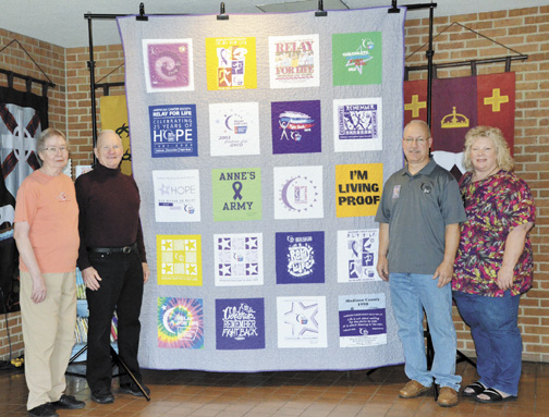 Messenger photo by Kristy Zurbrick The Presbyterian Crusaders Relay For Life team is taking bids on a one-of-a-kind Relay-themed t-shirt quilt. Representing the team are: (from left) quilt maker Marjorie Hopkins, London First Presbyterian Church pastor Rev. Gordon Johnson, and co-captains Jeffrey and Cheryl Baltzer.