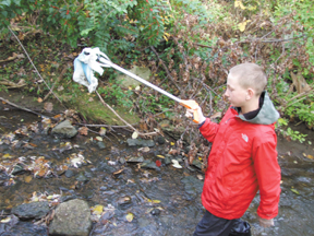 Messenger photo by Dedra Cordle Caleb Porter is careful not to touch any trash he found while cleaning up the streams around Grove City.