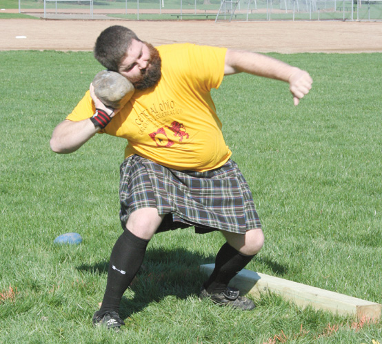 Brandon Crawford gets set to hurl a 24 pound stone as part of the Braemer Stone toss event. The stones for this event, which is an early version of today's shot put, can be of various shapes, according to the Great Lakes Scottish Athletic Association.