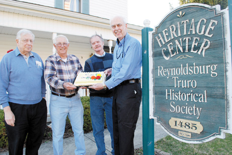 The Reynoldsburg Truro Historical Society kicked off its 40th anniversary with a celebration of the milestone during a March 31 meeting. Sharing a slice of the anniversary cake are, left to right, Richard Barrett, vice president; Richard Barth, a member of nearly two decades; Steve McLoughlin, president of the Whitehall Historical Society and Reynoldsburg Truro Historical Society President Mark Myers.