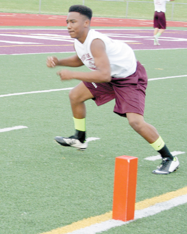 Freshman football player Darren Davis performing an agility drill at Friday Night Lights.