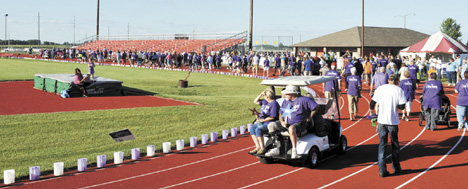 Messenger file photo Cancer survivors walk a lap around the track at the start of last year's Madison County Relay For Life. This year's Relay is set for June 19 at West Jefferson High School.