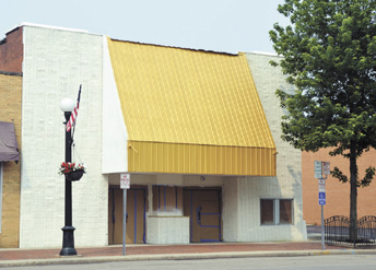 Messenger photo by Kristy Zurbrick Gone are the brown awning and tan bricks. A fresh coat of gold and white paint makes the London State Theater's exterior shine. The movie theater is set to reopen by the end of the summer.