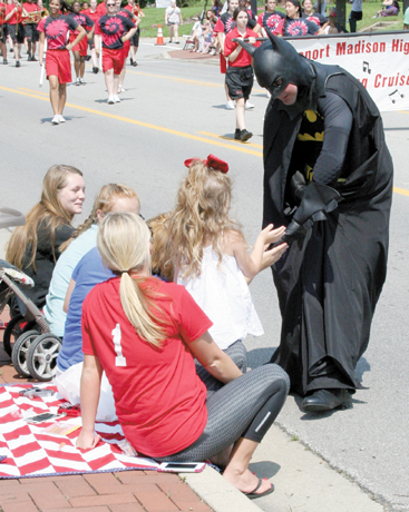 Batman greets one of his fans during the Groveport Fourth of July parade.
