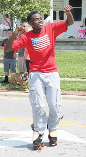 A dancing skater entertained the crowd during the Groveport Fourth of July parade.