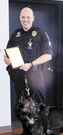 Messenger photo by Sandi Latimer West Jefferson Police Sgt. Brandon Smith and his  K-9 partner, Arc, were named Hometown Heroes of the Month. They were singled out for apprehending a serial bank robber in Dublin.