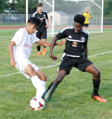 Groveport Madison Cruiser Jayson Singratsomeboune (11) (left) battles for the ball with a Reynoldsburg Raider.