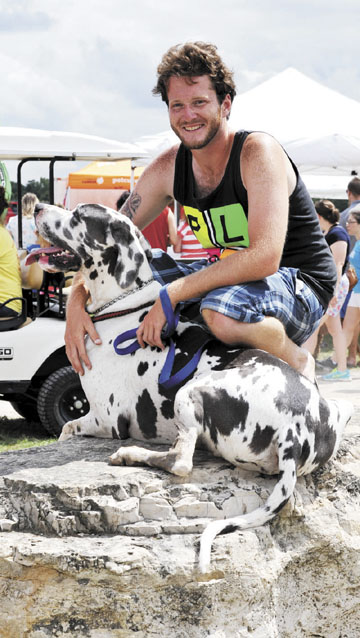 Messenger photos by Jeff Pfeil Tate Eberly of Powell and his Great Dane, Dozer, pose for pictures.